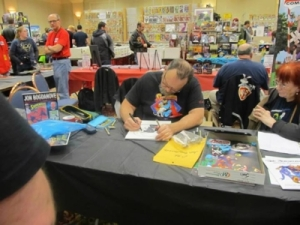 Jon Bogdanove scribbles on my Superman weddding album and Steel trade paperback!